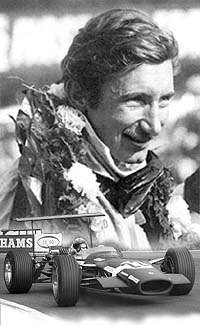 Jo Siffert after winning the 1968 British Grand Prix in the Rob Walker Racing Lotus Ford 49/R7.