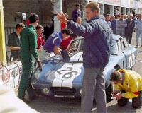 Allan Mann directs the pit work on the Bondurant/Schlesser coupe.
