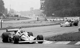 A brave Niki Lauda (#1) leads Brambilla's March through the chicanes at Monza on his way to a 4th place finish in his return to Formula 1 competition.
