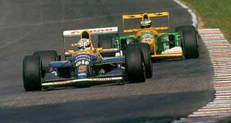 Mansell exited the pits ahead of a young Michael Schumacher but on fresh tires left the Benetton-Ford behind.