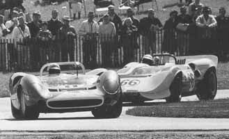Walt Hansgen and his Lola T70 work hard to stay ahead of the Type 2 that would ultimately score a decisive victory in the 500 mile race.