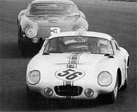 The Schlesser/Simon Cobra coupe leads the Biscaldi/Baghetti Ferrari during the late part of the race.